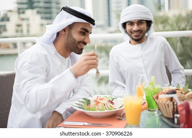 Two Arab Men Eating in a Restaurant