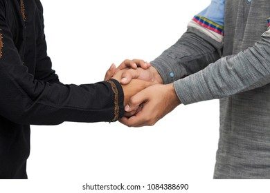 Two Arabic Pakistani Indian Muslim boy man are shaking hands on white background, Business Successful concept, Close up of Arab businessman's hands are shaking hands over a deal,  hand on shoulder.