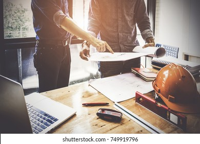 Two Architect man working with compasses and blueprints for architectural plan,engineer sketching a construction project concept. - Shutterstock ID 749919796