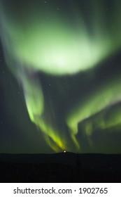 Two arcs of aurora borealis in nights sky