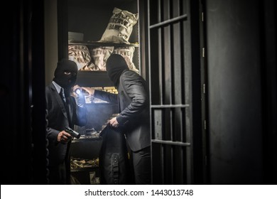 Two ardmed men robbing a bank