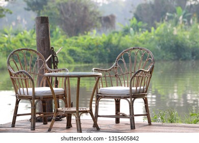 Two armrests Placed on a wooden balcony by the river In the midst of nature.