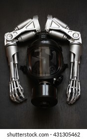 Two arms of the robot and a gas mask on a dark background.