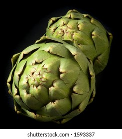 Two artichokes isolated on black