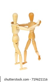Two artist's manikins dancing isolated against white