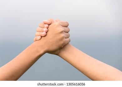 Two Asia female hands holding each other strongly