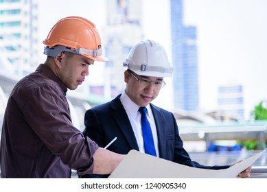 Two asian business and engineer man has planning and working for design buiding and city.