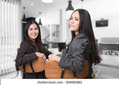 Two asian business women having a meeting in modern office