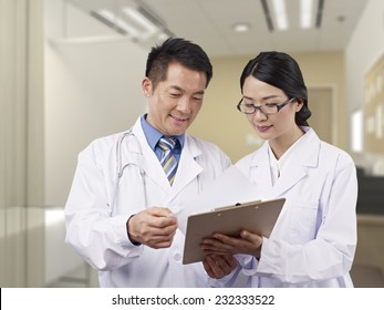two asian doctors having a discussion.