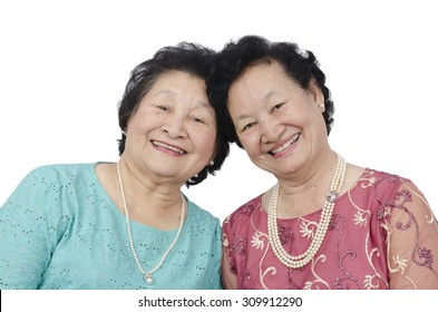 two asian elderly woman on white background
