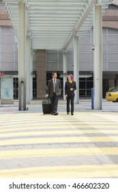 Two Asian executive wearing suit at the Zebra Crossing