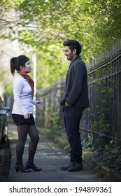 Two Asian friends walking outdoors. Young urban couple 'hanging out' in the city.
