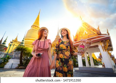 Two asian girlfriends traveling and check location by a map in Grand Palace and Wat phra kaew Bangkok city,Thailand