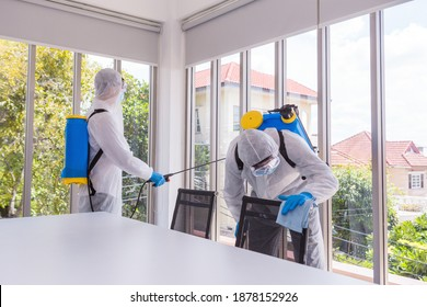 Two Asian men are disinfecting an office building. Big cleaning day. Background and copy space.