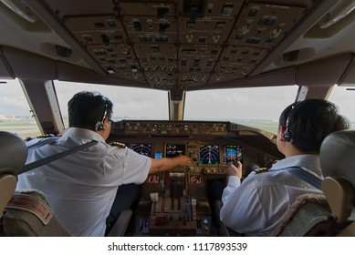 Two asian pilots in airplane cockpit were operating the airplane. Captain performing pilot monitor duty was requested to retract landing gear to up position by Co-pilot who performing pilot fly duty.