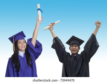 Two Asian students with graduation cap and gown and diploma