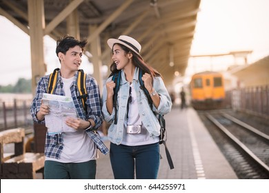 Two Asian Tourists With Backpacks Train travel in Sightseeing City,Vintage Style.