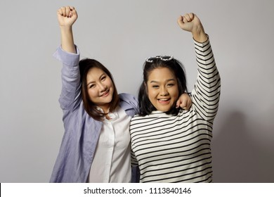 Two Asian women on the white background.