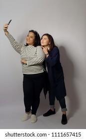 Two Asian women taking the photo.