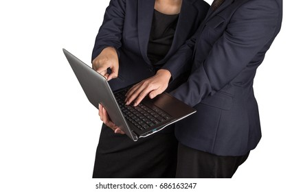 Two Asian young businesswoman or working woman standing and pointing at the laptop. Two asian woman holding her notebook isolated on white background.