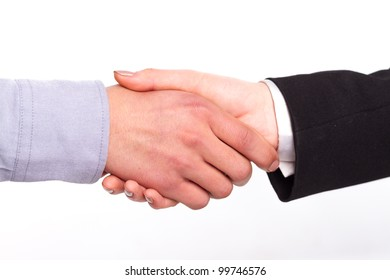 Two Asians, shaking hands, wearing a shirt and suit