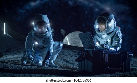 Two Astronauts Collect Rock and Soil Samples on the Alien Planet. Space Travel and Exploration, Finding Habitable Planet, Colonization Concept.