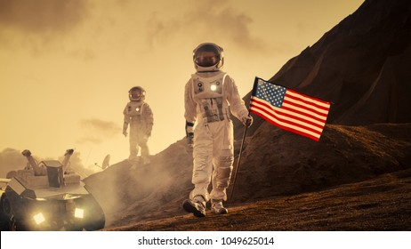 Two Astronauts Explore Mars/ Red Planet. One Cosmonaut Carries American Flag. Technological Advance Brings Space Exploration, Travel, Colonization Concept.