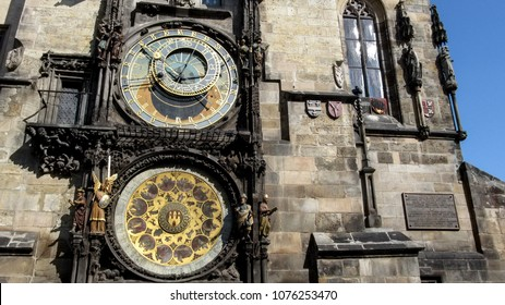 Two  astronomical dials of  Prague astronomical clock (or Prague orloj) close-up. The astronomical dial, statues of various Catholic saints and a calendar dial with medallions representing the months