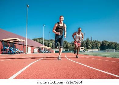 Two athletes fun finish in the stadium