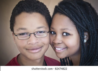 Two attractive African American teenagers. One male, one female.