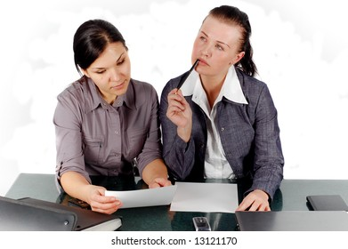 two attractive business women in office