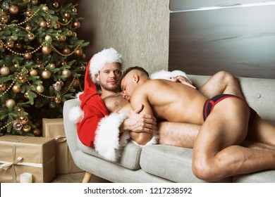 Two attractive guys and christmas.