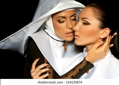 Two attractive sexy nuns. Halloween