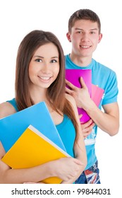 Two attractive students with books isolated on a white background