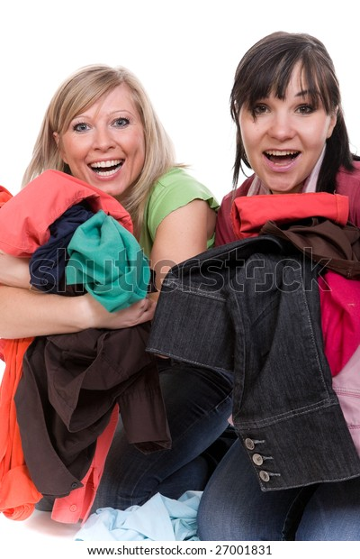 two attractive women with clothes