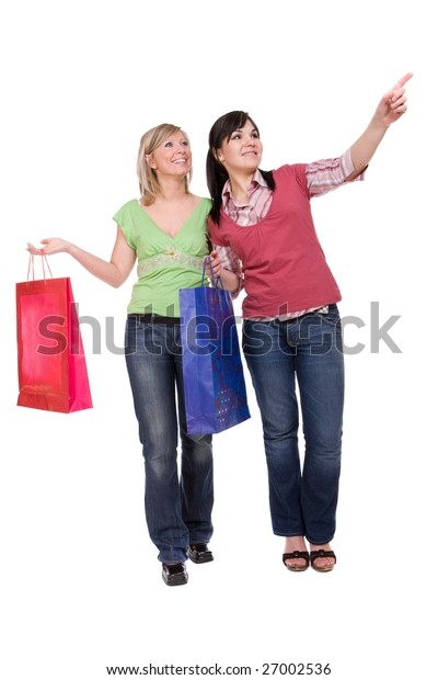 two attractive women with shopping bags. over white background