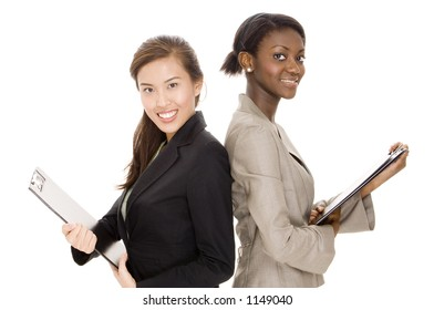 Two attractive young business women with clipboards on white background