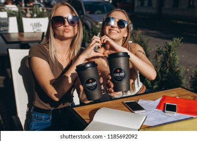 Two attractive young positive nice girls do selfie in street cafe in european street cafe. August 2018, Prague