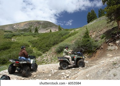 Two ATV riders pause on a trail on Mt. Princeton in the Colorado Rockies