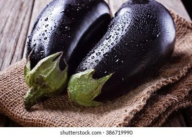 Two aubergines on burlap sack