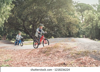 Two australian kids riding their bicycles on special bike track in Adelaide, South Australia