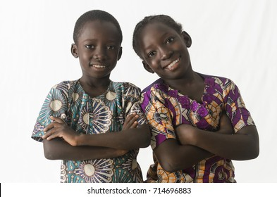 Two awesome African children posing with arms crossed, isolated