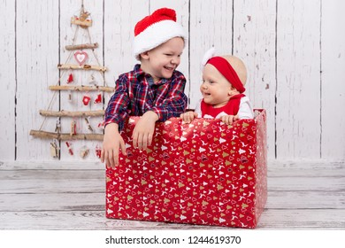 two babies boy and girl are sitting in the giftbox