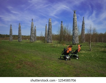 Two baby strollers on  meadow in Kaluga region in Russia