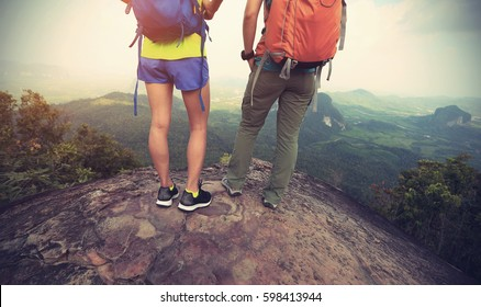 two backpackers hiking at mountain top enjoy the view
