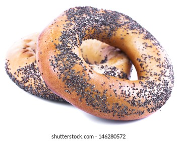 Two bagels with poppy seeds on a white background
