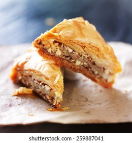 two baklava halves sitting on wax paper