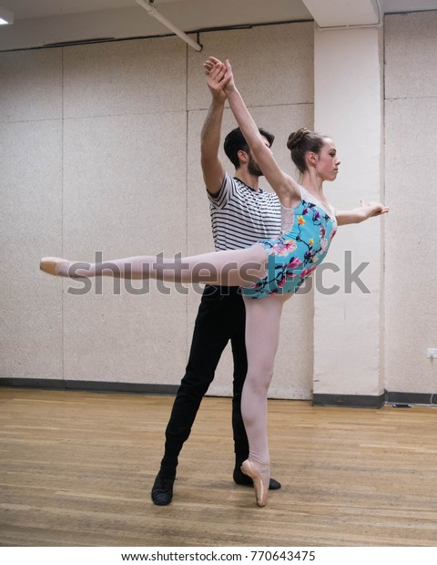 Two Ballet Dancers Rehearse Partnering Routine Stock Photo