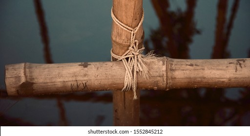 Two bamboo sticks tied with white nylon ropes photo