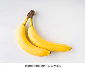 Two bananas on white background. Minimal flat lay